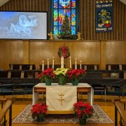 poinsettias on the altar